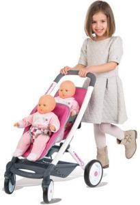 Игрушечная коляска для двух кукол.