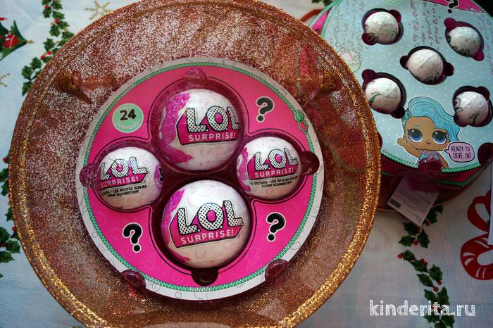 Шарики L.O.L. внутри золотого шара.