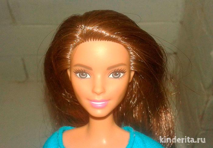 Лицо гимнастки Barbie.