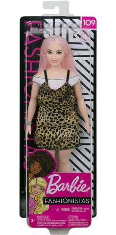 Кукла с розовыми волосами в юбке в горох.