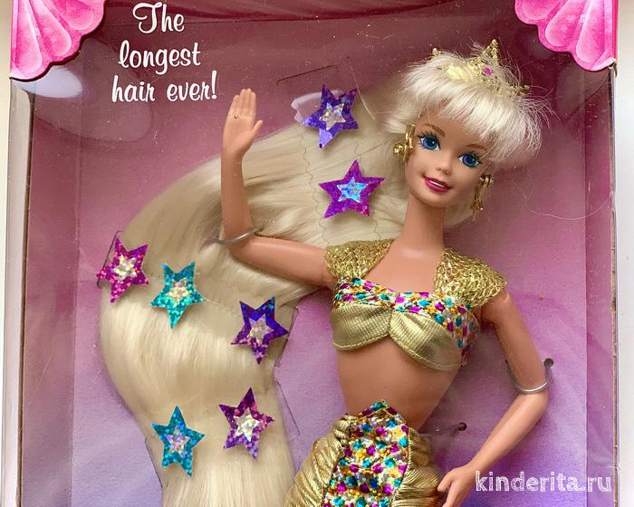 Старенькая Барби Русалка с длинными волосами и золотым хвостом.